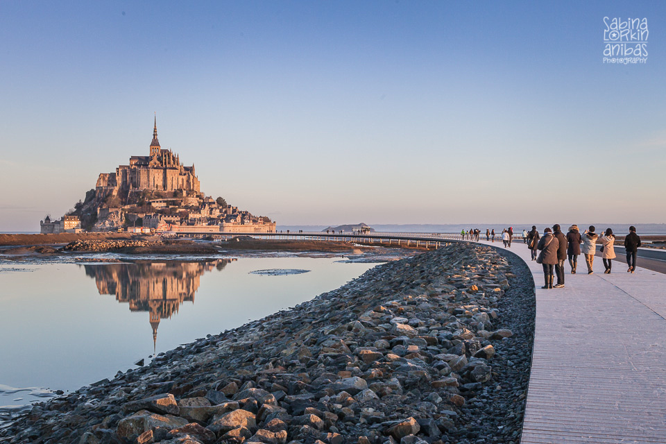 Discover photos of the Mont St Michel at high tide at sunrise in winter by British photographer in Normandy Sabina Lorkin