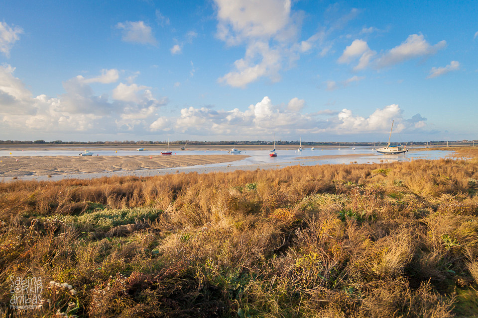 Landscape Photographer Normandy // Discover the beautiful views of the boats at low tide on a sunny autumn afternoon at Regnéville-sur-Mer Manche Normandy Sabina Lorkin