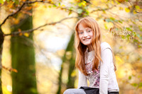 Family Photographer - A flame haired girl in Normandy woodland